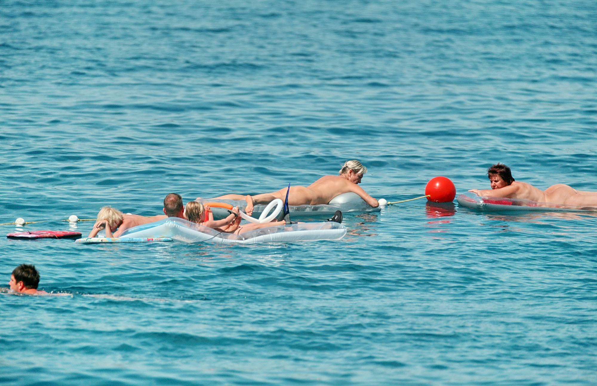 Pure Nudism Photos Adult On Water Floaters - 3