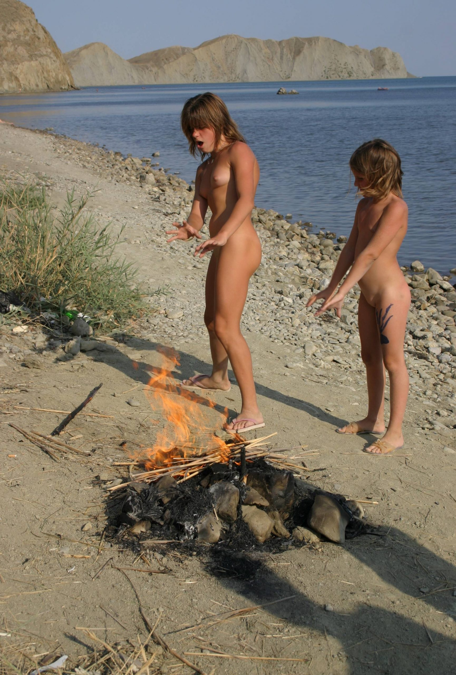 Pure Nudism Pics-Beachfront Fire Jumping - 3