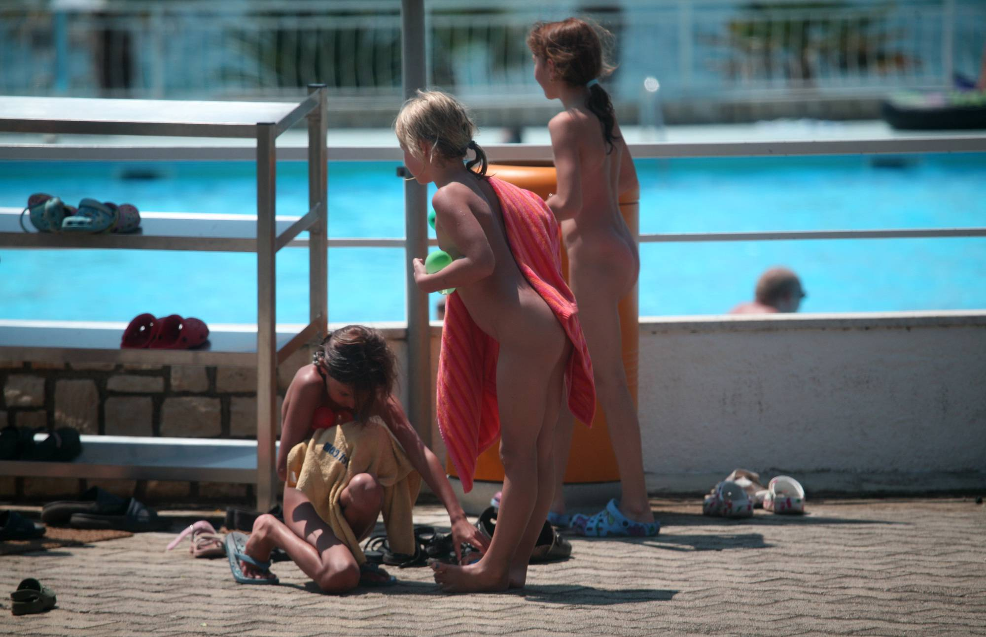 Pure Nudism Photos-Group Huddle By The Pool - 1
