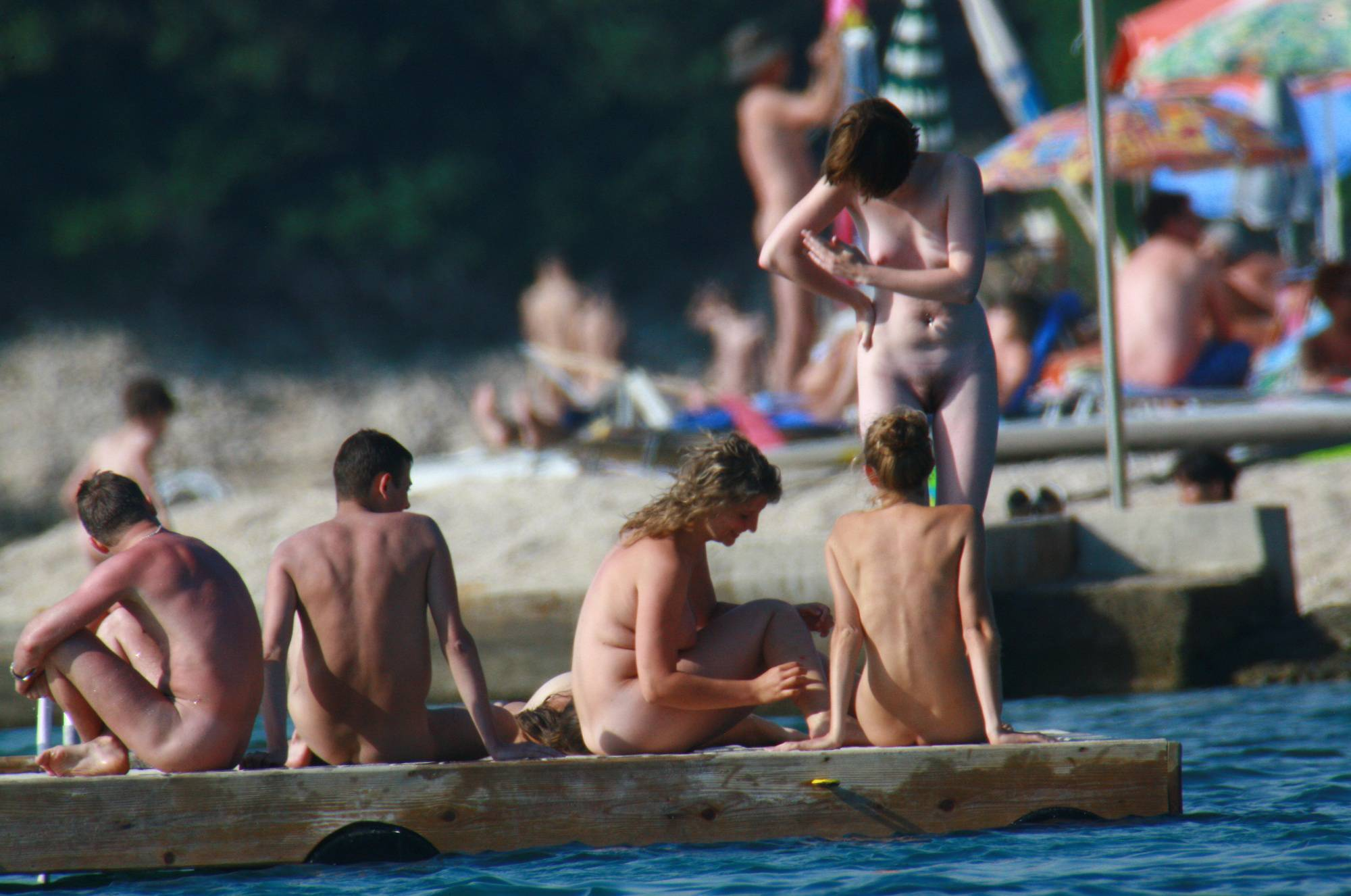 Nudist Slab Group Tanning - 1