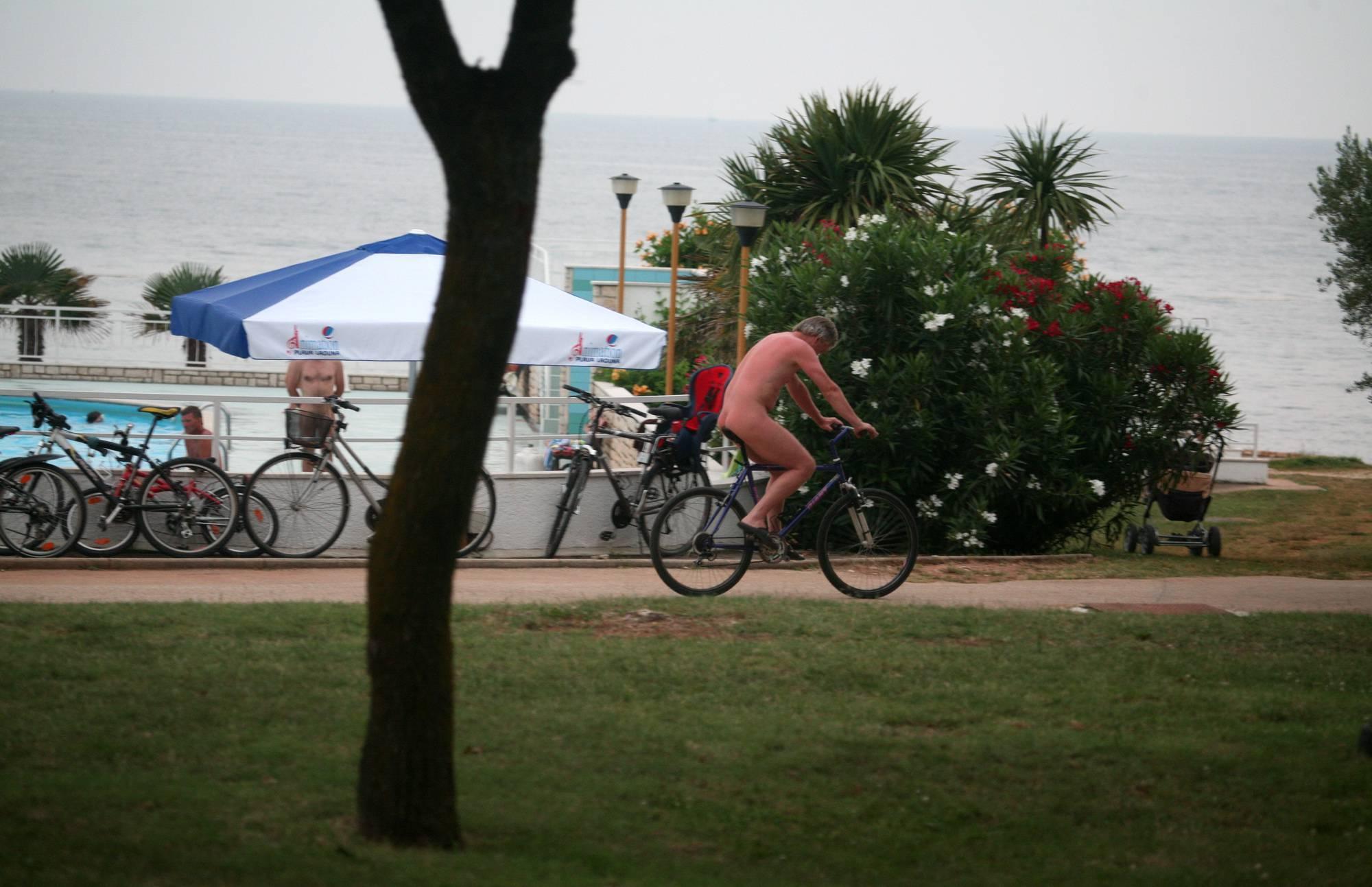 Naturist Poolside Biking - 2