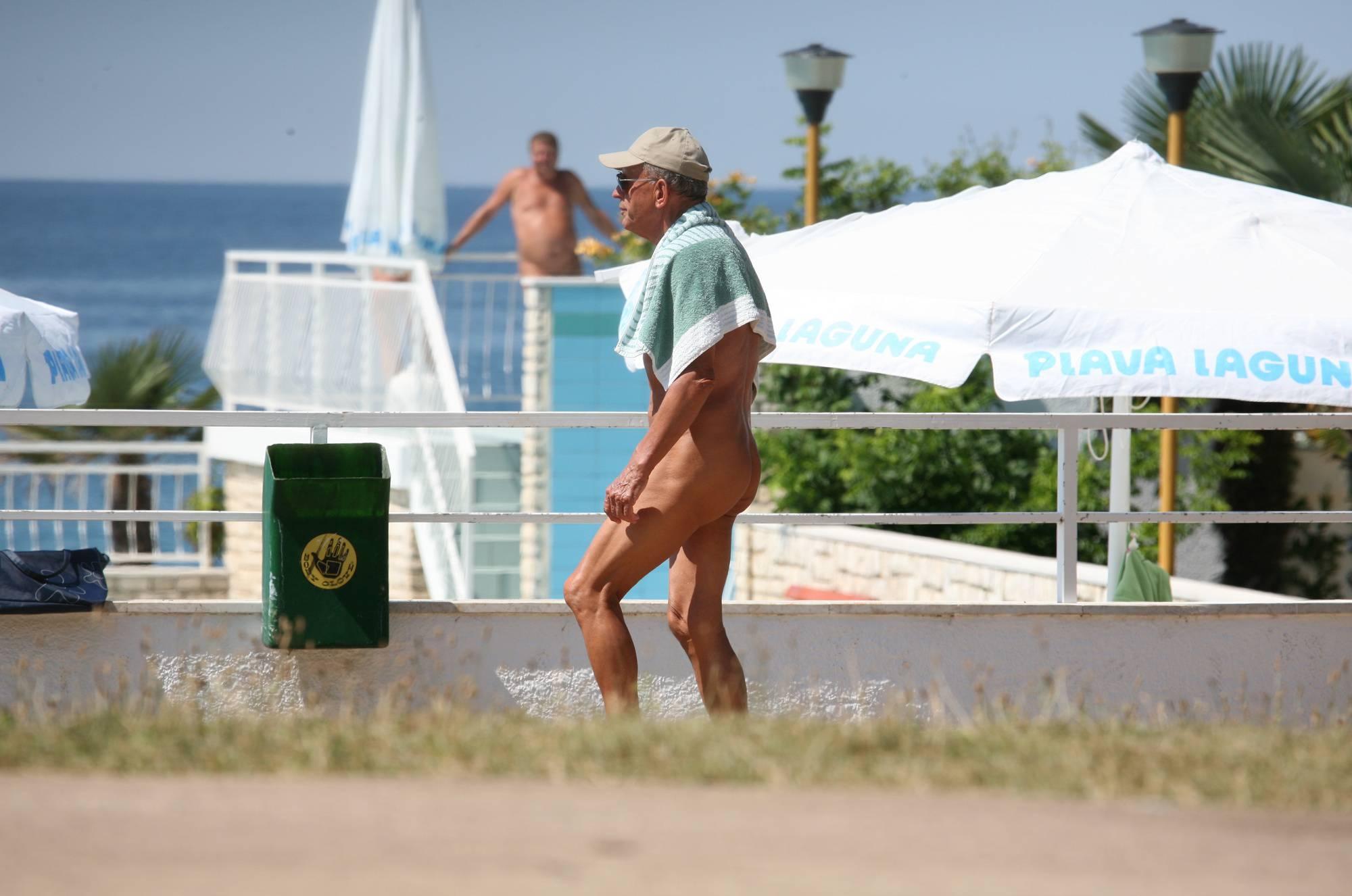 Pure Nudism Photos-Nuda Pool Visitor Walk-By - 2