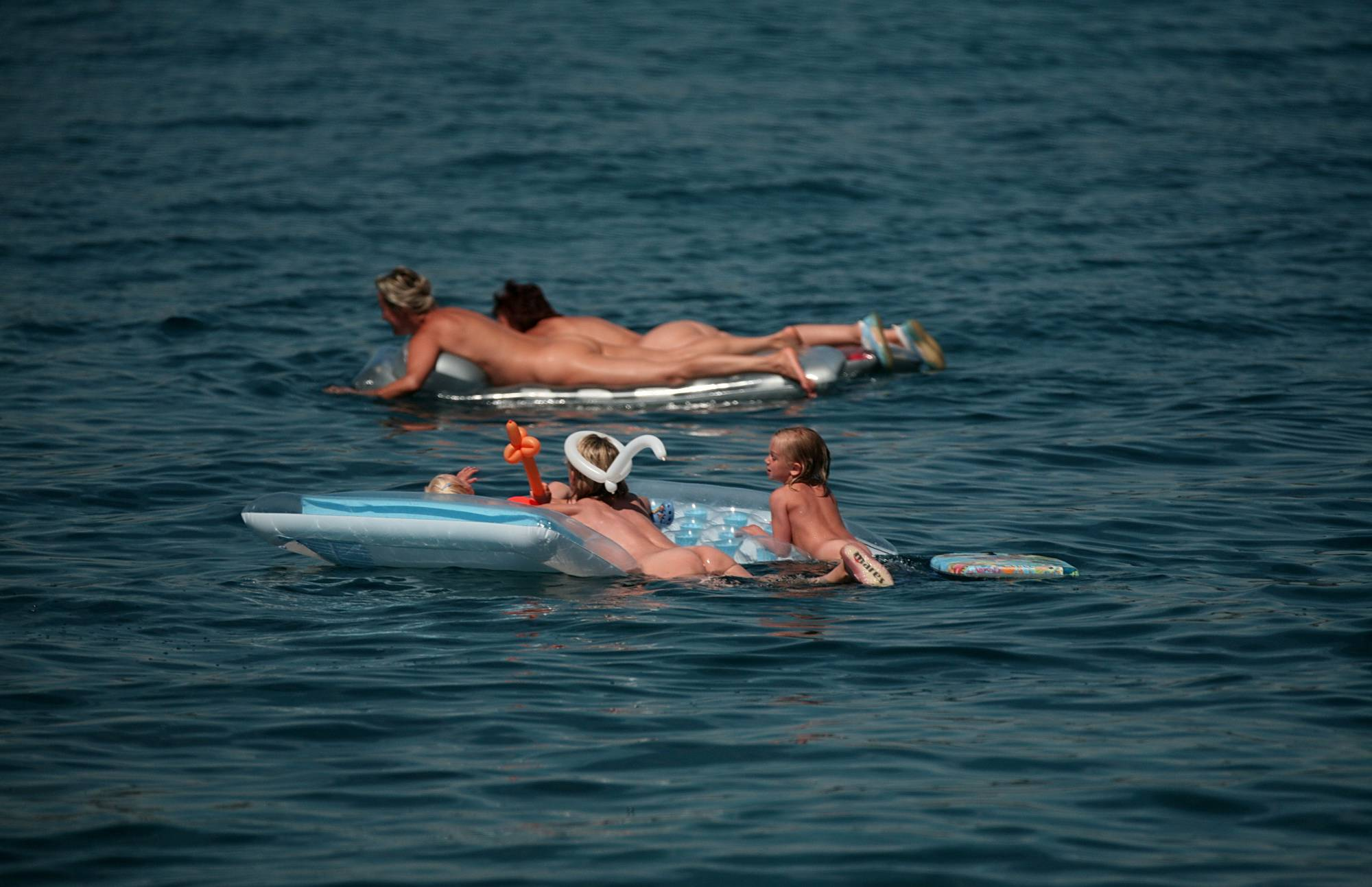 Purenudism Photos-Swimming With Float Rafts - 1