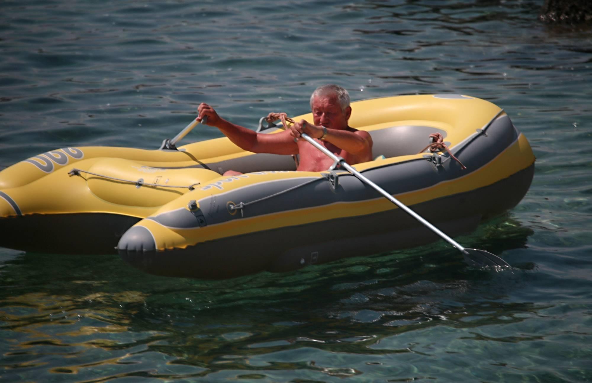 Purenudism Gallery-Lone Nudist in Yellow Boat - 4