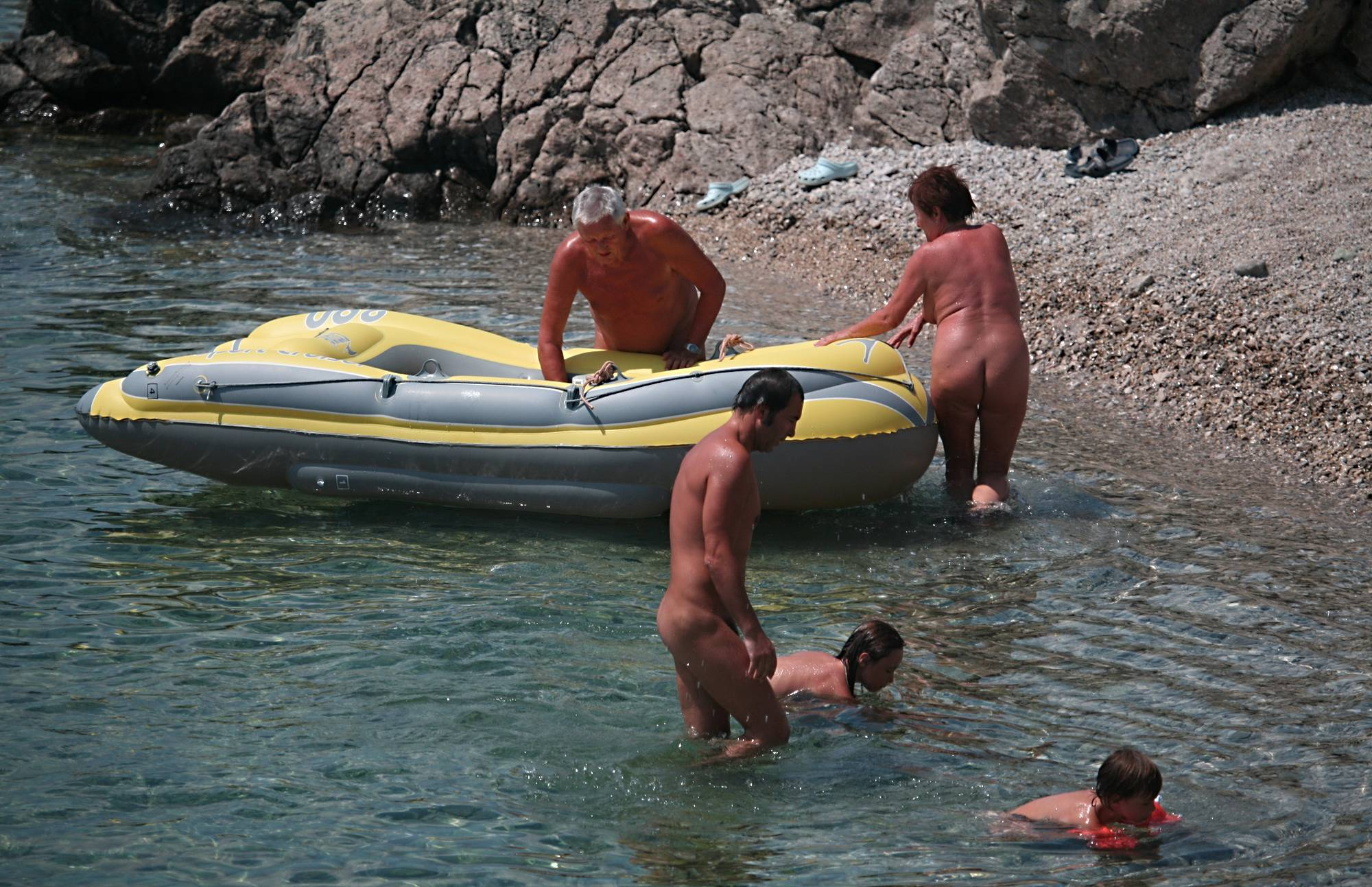 Purenudism Pics-Lone Nudist in Yellow Boat - 3