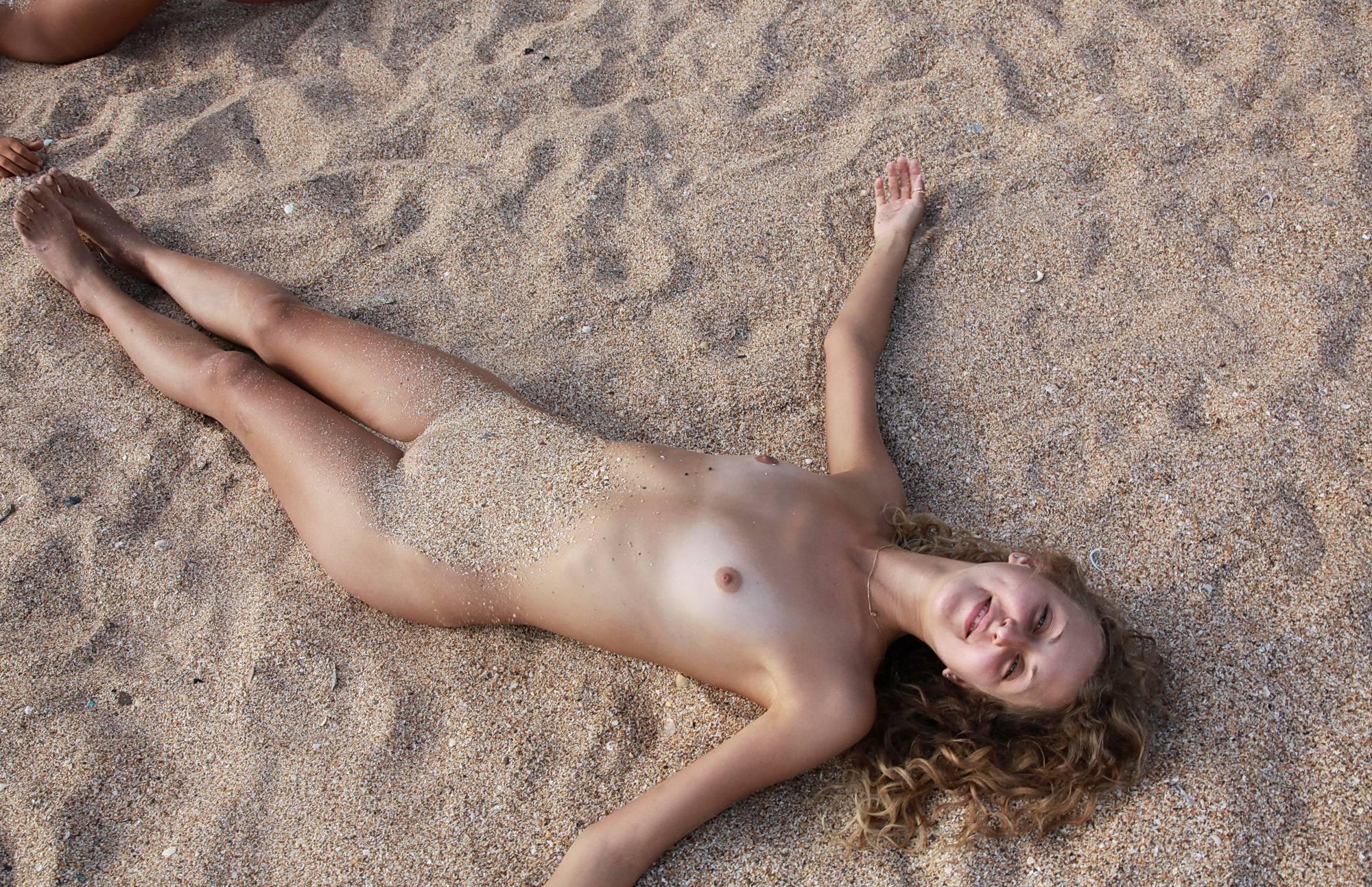Sandy Nudists Relaxing - 1