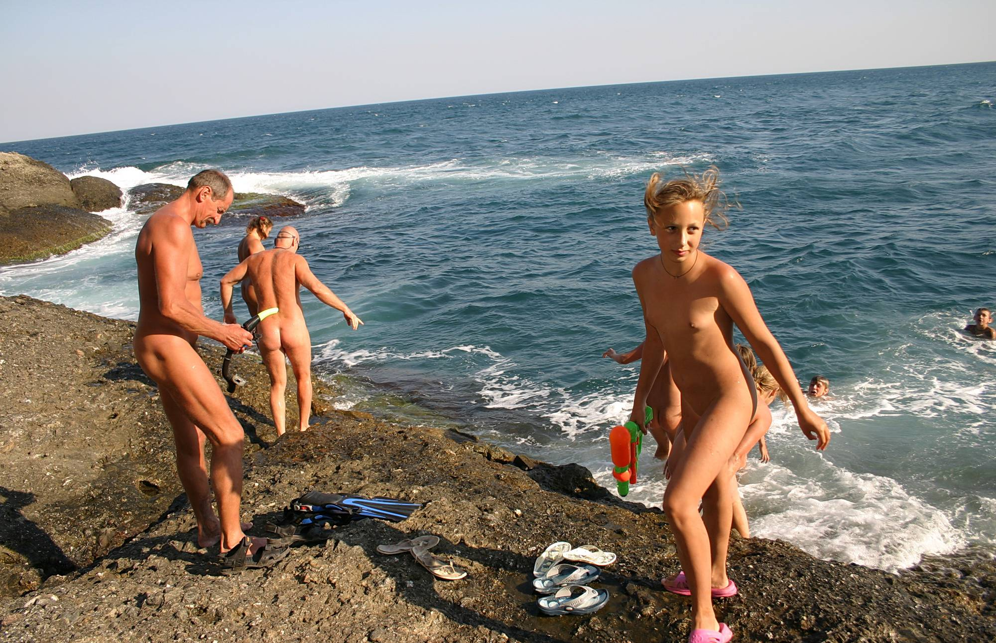 Pure Nudism Pics-Swim By The Rocky Shore - 3