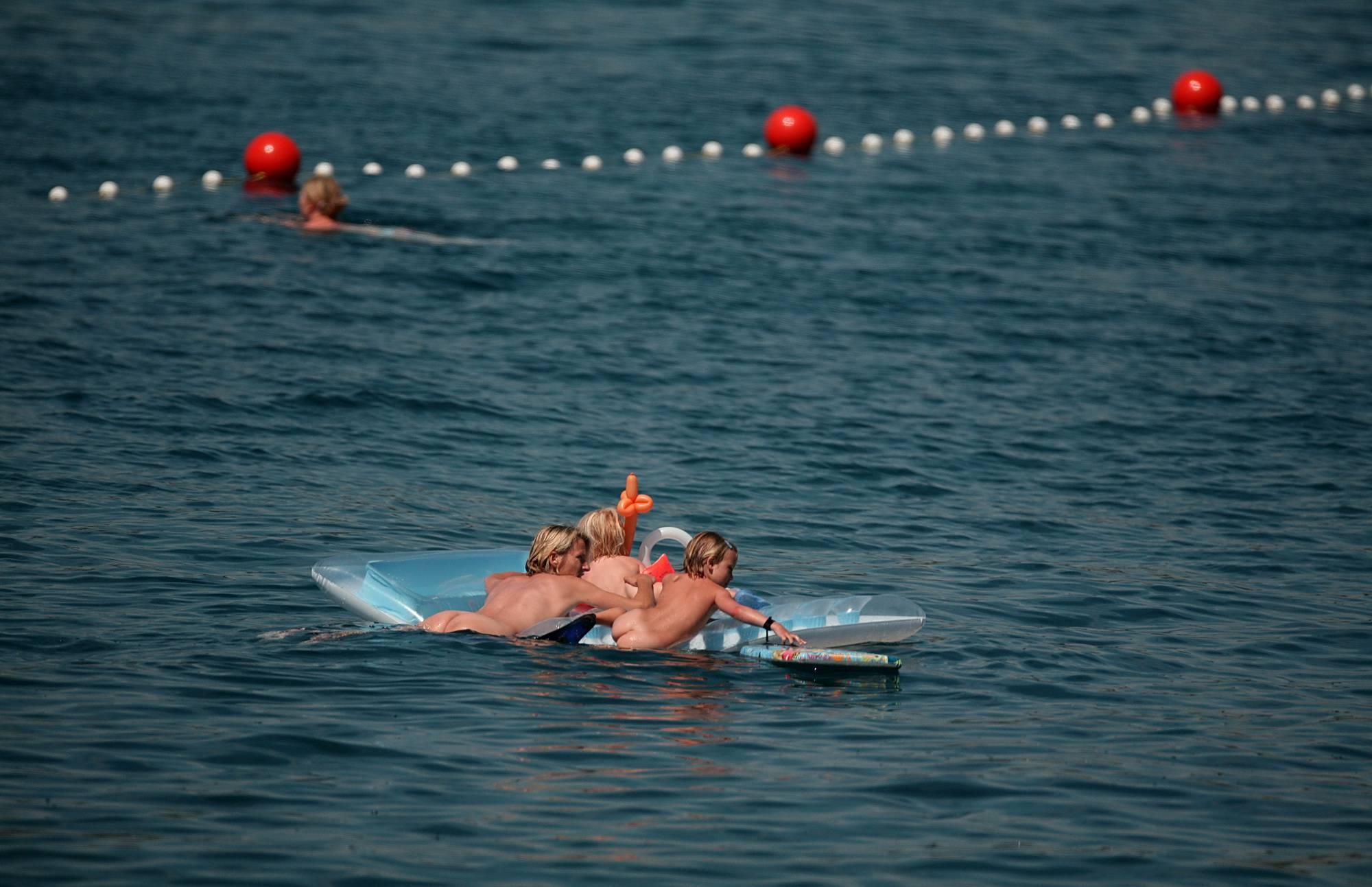 Purenudism Images-Swimming With Float Rafts - 3